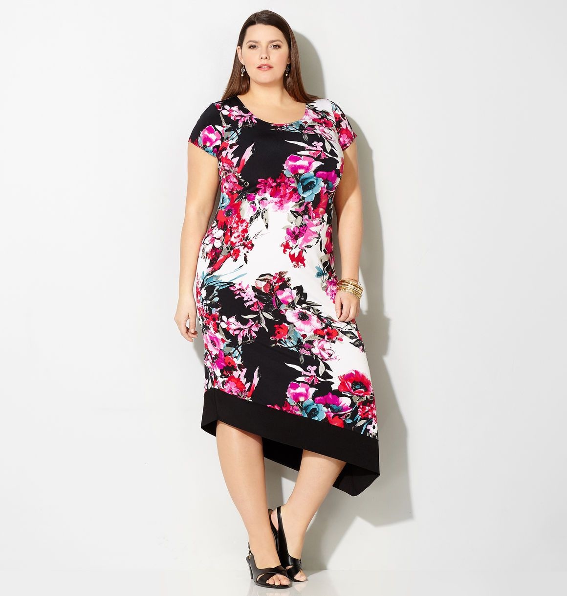 Shop new plus size spring dresses in sizes 14-32 like the Pink Floral  Asymmetrical Sheath available online at Traveller Location. Avenue Store