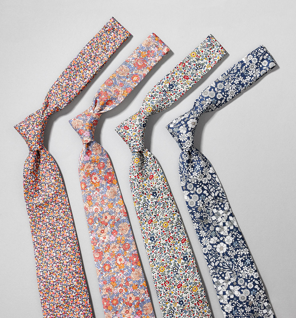 row of four floral ties